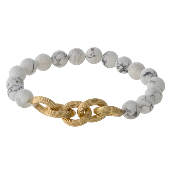 "Natural stone beaded stretch bracelet featuring a gold chain link detail. Approximately 3"" in diameter. Fits up to a 6"" wrist."