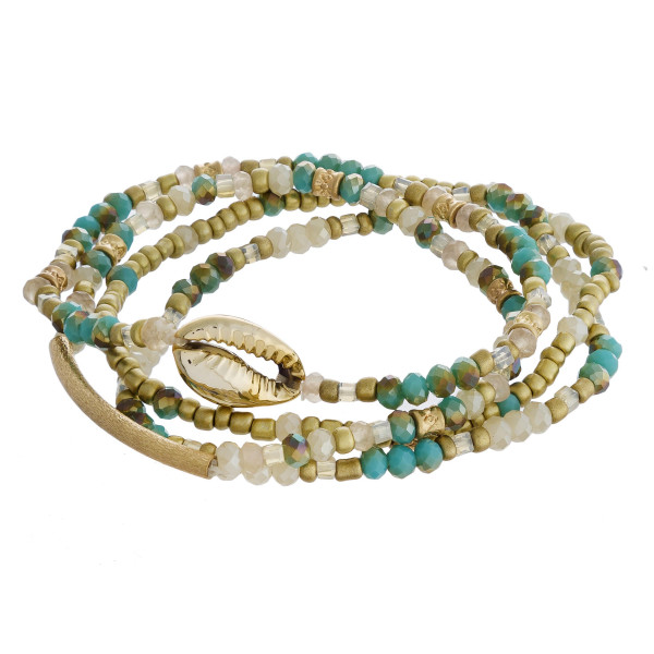 "Bracelet set featuring four beaded stretch bracelets with faceted bead details, a puka shell and gold metal accents. Approximately 3"" in diameter unstretched. Fits up to a 6"" wrist."