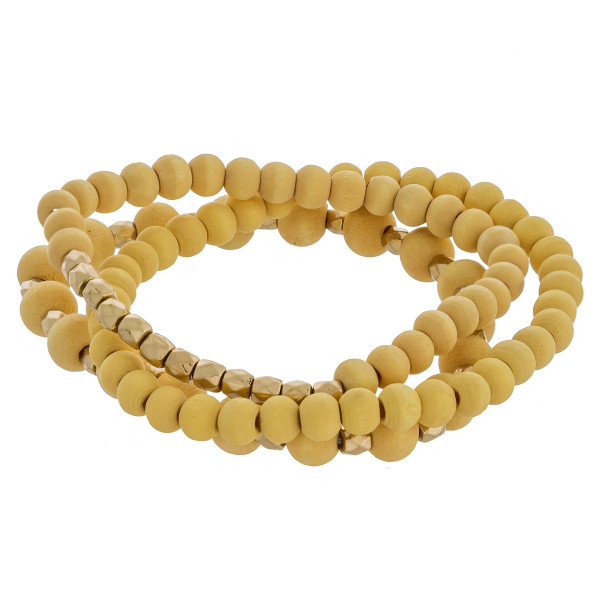 "Wooden beaded stretch bracelet with gold bead focal detail. Approximate 6"" in length."