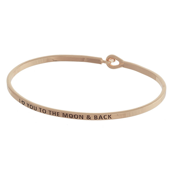 "Metal bracelet with engraved message, ""I (heart) You To The Moon & Back."" Approximate 2"" in diameter."