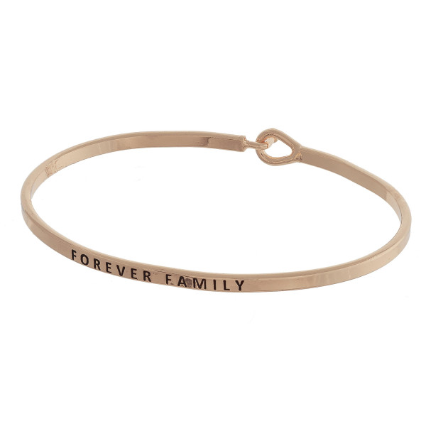 "Dainty metal bracelet featuring ""Forever Family"" engraved message with a hook closure. Approximately 2.5"" in diameter. Fits up to a 5"" wrist."