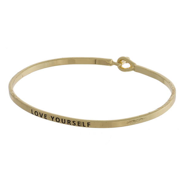 "Metal bracelet with engraved message, ""Love Yourself."" Approximate 2"" in diameter."
