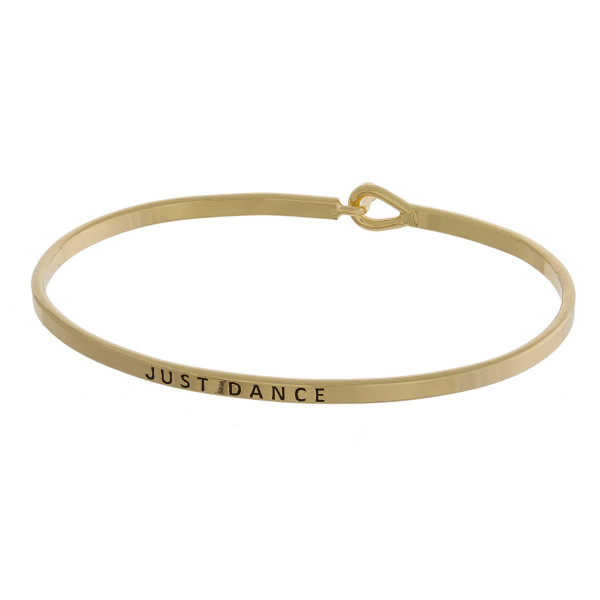 """Metal bracelet with engraved message just dance. Approximate 2"""" in diameter."""