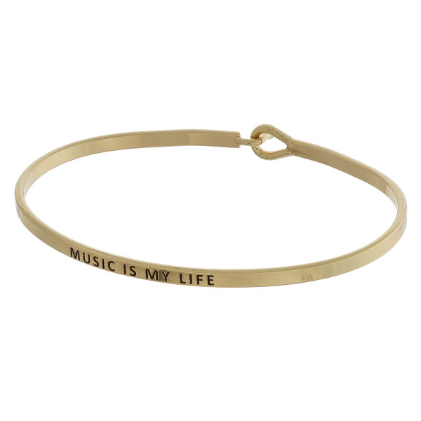 """Metal bracelet with engraved message music is my life . Approximate 2"""" in diameter."""