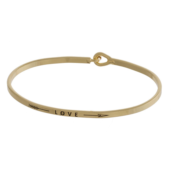 """Metal bracelet with engraved message love. Approximate 2"""" in diameter."""