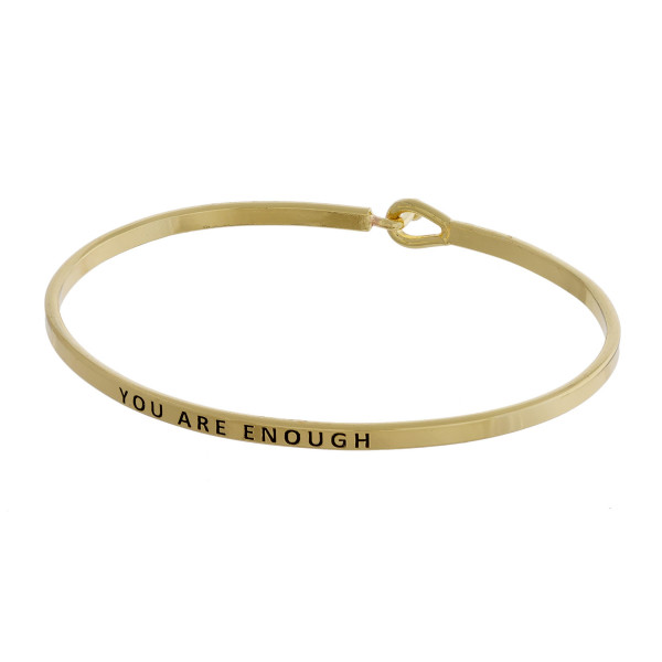 """Metal bracelet with engraved message you are enough. Approximate 2"""" in diameter."""
