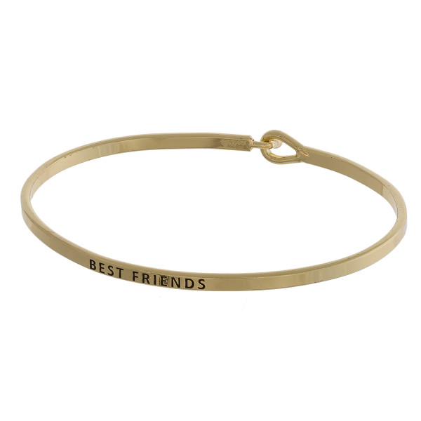 """Metal bracelet with engraved message best friends. Approximate 2"""" in diameter."""