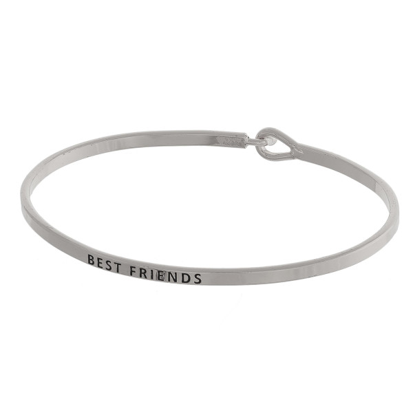 "Dainty metal bracelet featuring ""Best Friends"" engraved message with a hook closure. Approximately 2.5"" in diameter. Fits up to a 5"" wrist."