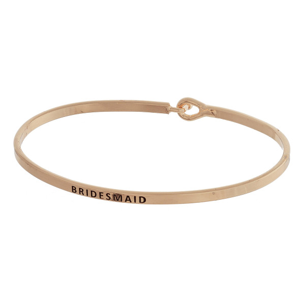 """Metal bracelet with engraved message bridesmaid . Approximate 2"""" in diameter."""
