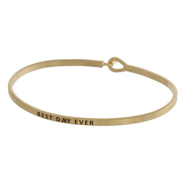 """Metal bracelet with engraved message best day ever. Approximate 2"""" in diameter."""
