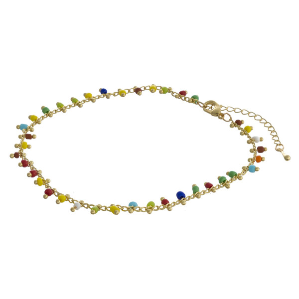 "Beaded anklet featuring plastic bead details with gold accents. Approximately 4"" in diameter. Fits up to 8"" ankle."