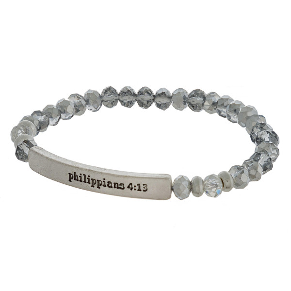 "Beaded stretch bracelet featuring a metal accent engraved with the bible verse ""Philippians 4:13"". Approximately 2.5"" in diameter unstretched. Fits up to a 6"" wrist."