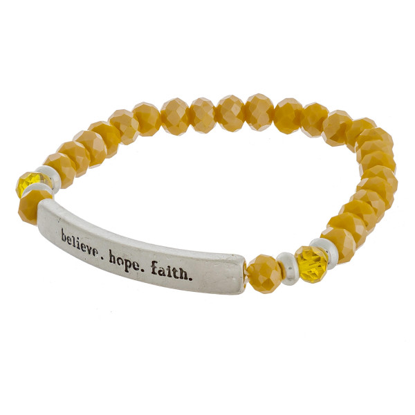 """Beaded stretch bracelet featuring a metal accent engraved with """"believe. hope. faith."""" Approximately 3"""" in diameter unstretched. Fits up to a 6"""" wrist."""