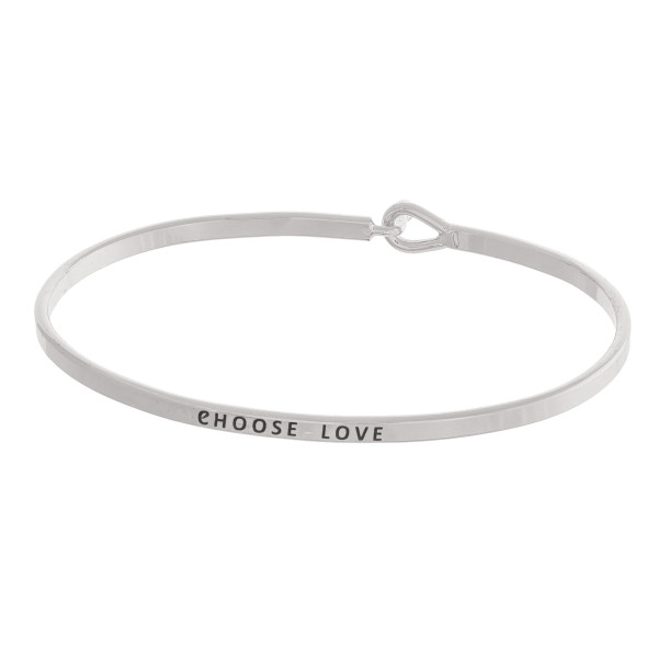 "Metal bracelet with engraved message, ""Choose Love."" Approximate 2"" in diameter."