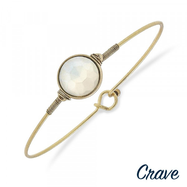 "Dainty gold metal bracelet with a crystal inspired focal. Approximately 2.5"" in diameter. Fits up to a 5"" wrist."