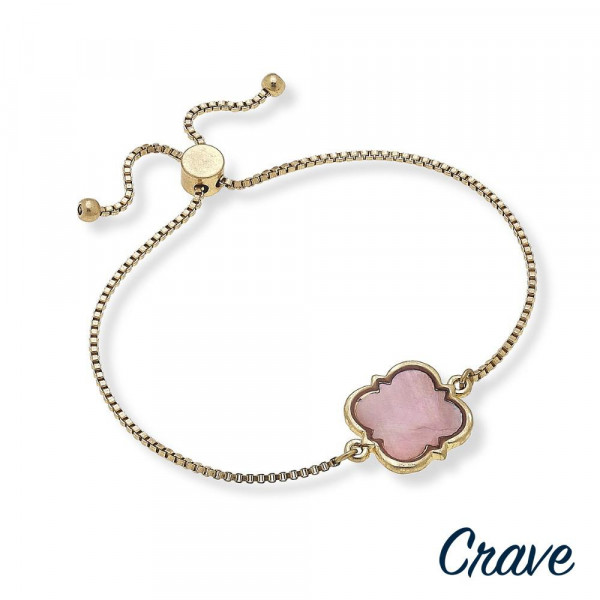 """Metal bracelet with clover and pearl details. Approximate 9"""" in length."""