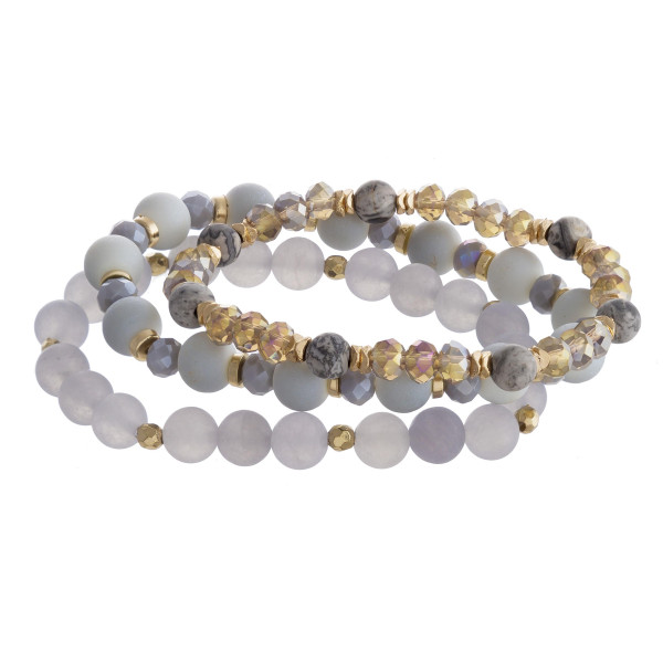 "Breaded bracelet set featuring three stretch bracelets with natural stone inspired bead details and gold accents. Approximately 3"" in diameter unstretched. Fits up to a 6"" wrist."