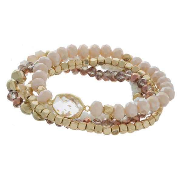 "Bracelet set featuring four stretch bracelets with a iridescent faceted focal, beaded details and gold accents. Approximately 3"" in diameter unstretched. Fits up to a 6"" wrist."