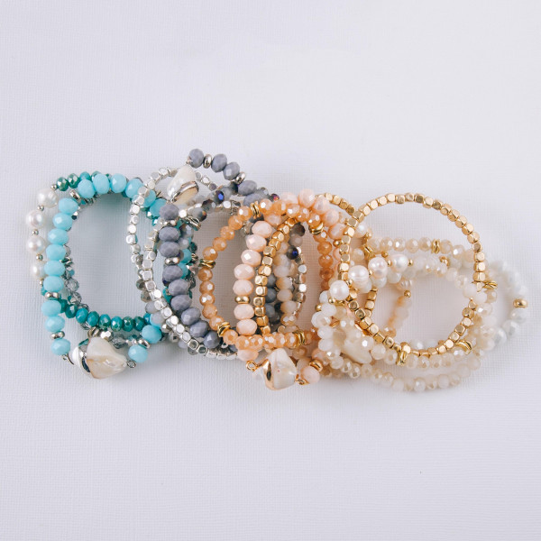"""Bracelet set featuring four beaded stretch bracelets with faux pearls, faceted bead details and gold metal accents. Approximately 3"""" in diameter unstretched. Fits up to a 6"""" wrist."""