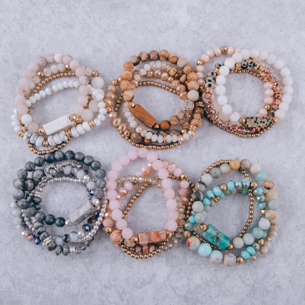 """Bracelet set featuring four stretch bracelets with a natural stone inspired focal, faceted and iridescent beaded details with gold accents. Approximately 3"""" in diameter unstetched. Fits up to a 6"""" wrist."""