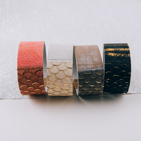 """Genuine leather bracelet featuring mermaid scale inspired details and a magnetic closure. Approximately 3"""" in diameter. Fits up to a 6"""" wrist."""