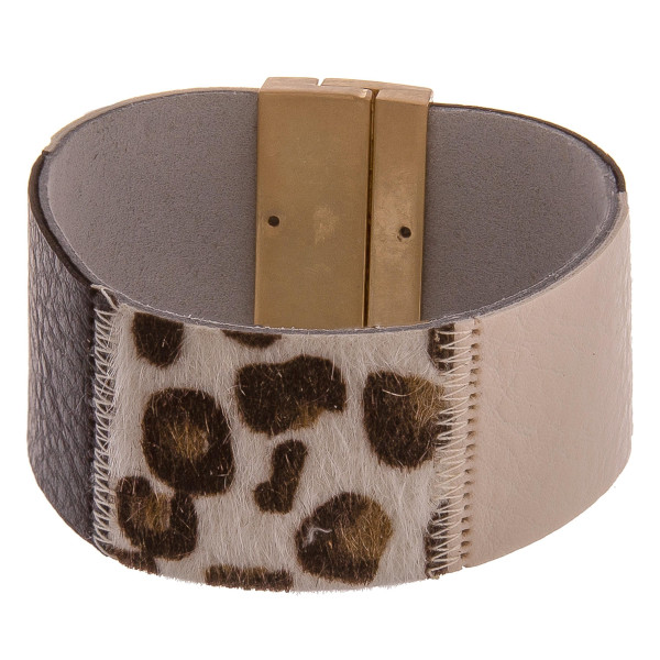 """Multi-colored leather cuff bracelets featuring animal print accents and a magnetic closure. Approximately 8"""" in length. Fits up to a 4.5"""" wrist."""