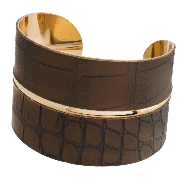 """Snakeskin faux leather cuff bracelet featuring a druzy natural stone focal with rhinestone details. Approximately 2.5"""" in diameter. Fits up to a 5"""" wrist."""