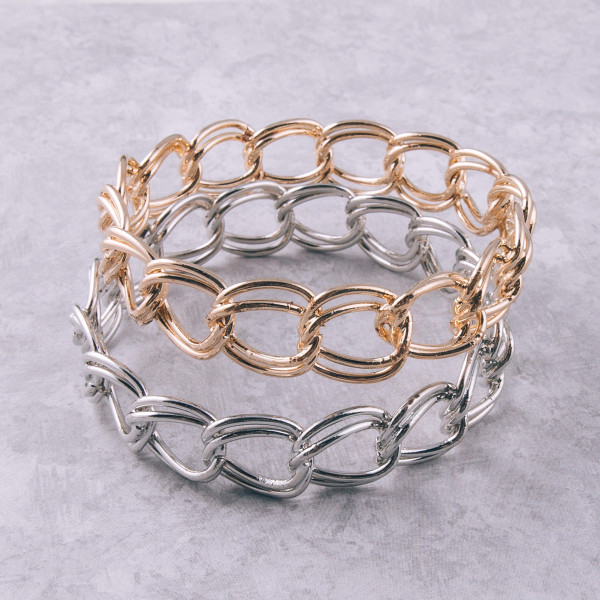 """Silver chain linked metal bracelet. Approximately 3"""" in diameter. Fits up to a 6"""" wrist."""