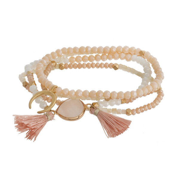 "Bracelet set featuring four stretch beaded bracelets with a natural stone focal, a crescent detail and tassel accents. Approximately 2.5"" in diameter unstretched. Fits up to a 5"" wrist."