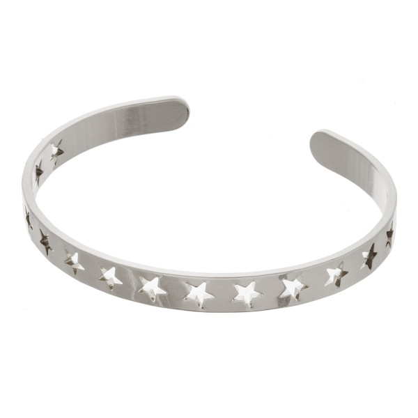"Metal cuff bracelet featuring cut out star accents. Approximately 2.5"" in diameter. Fits up to a 5"" wrist."