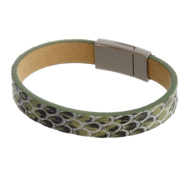 """Genuine leather bracelet featuring snakeskin inspired details and a magnetic closure. Approximately 3"""" in diameter. Fits up to a 6"""" wrist."""