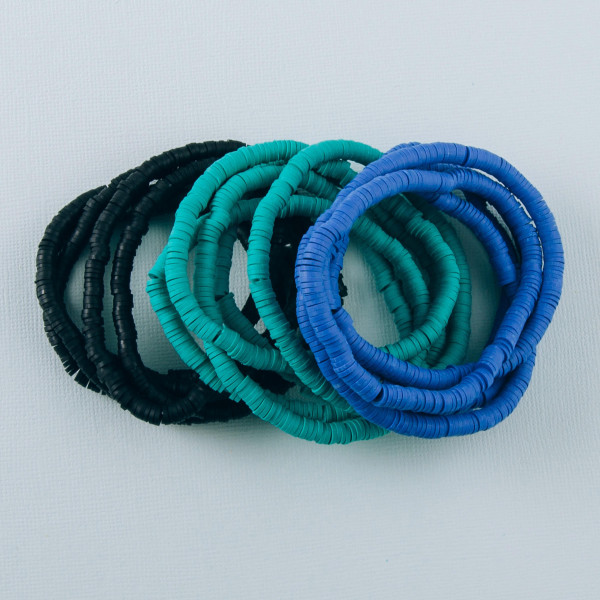 """Bracelet set featuring five beaded stretch bracelets with plastic bead details. Approximately 3"""" in diameter unstretched. Fits up to a 6"""" wrist."""