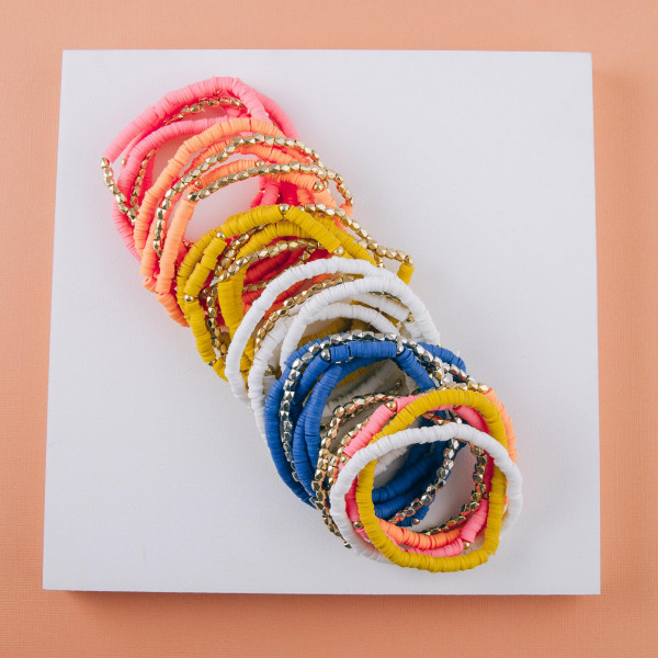 """Bracelet set featuring five beaded stretch bracelets with plastic bead details and gold accents. Approximately 3"""" in diameter unstretched. Fits up to a 6"""" wrist."""