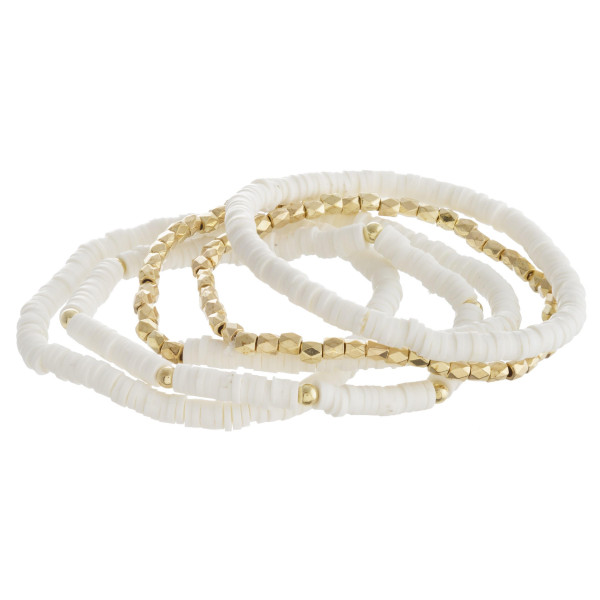 "Bracelet set featuring five beaded stretch bracelets with plastic bead details and gold accents. Approximately 3"" in diameter unstretched. Fits up to a 6"" wrist."