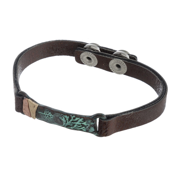 """Faux leather bracelet featuring a metal focal with an engraved tree detail and adjustable snap on closure. Approximately 3"""" in diameter. Fits up to a 6"""" wrist."""