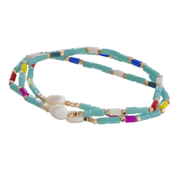 "Beaded bracelet set featuring three stretch bracelets with iridescent bead details and pearl accents. Approximately 3"" in diameter unstretched. Fits up to a 6"" wrist."