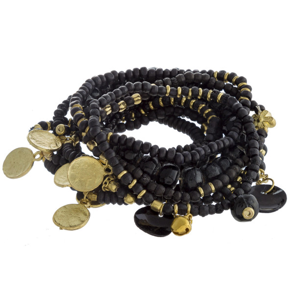 """Bracelet set featuring ten beaded stretch bracelets with faceted bead details and gold metal accents. Approximately 3"""" in diameter unstretched. Fits up to a 6"""" wrist."""