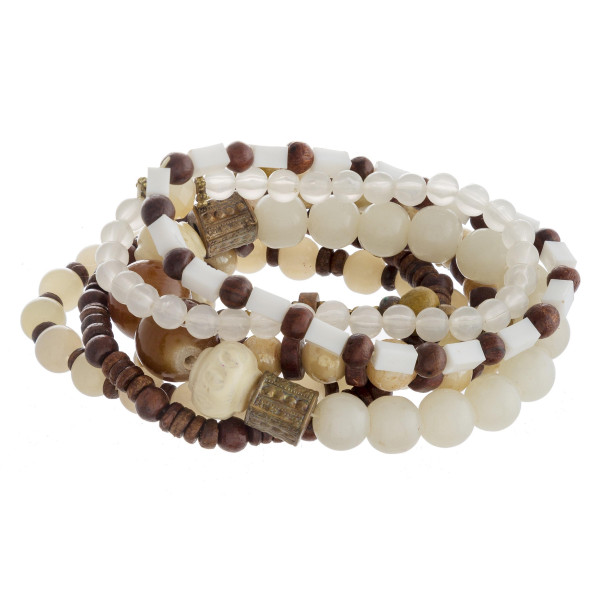 "Bracelet set featuring eight natural stone, wood beaded stretch bracelets with gold metal accents. Approximately 3"" in diameter unstretched. Fits up to a 6"" wrist."