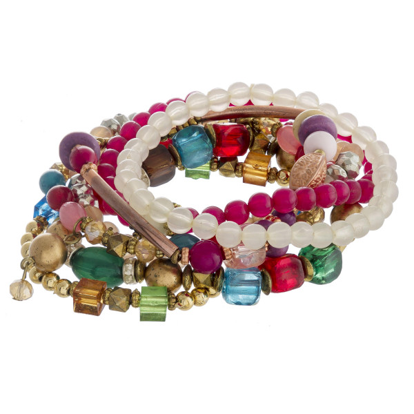 "Bracelet set featuring eight beaded bracelets with natural stone bead details and gold metal accents. Approximately 3"" in diameter unstretched. Fits up to a 6"" wrist."
