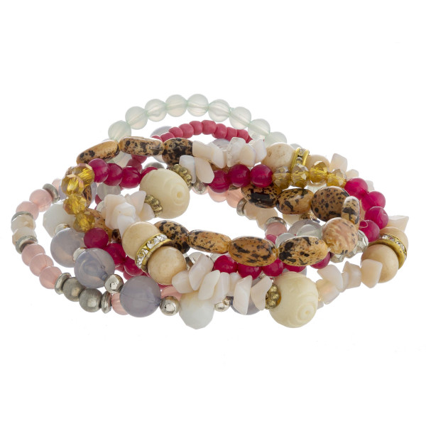 "Bracelet set featuring eight natural stone, iridescent beaded details with silver and gold accents. Approximately 3"" in diameter unstretched. Fits up to a 6"" wrist."