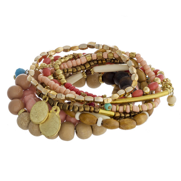 "Bracelet set featuring ten wood beaded stretch bracelets with gold metal accents and multi charms. Approximately 3"" in diameter unstretched. Fits up to a 6"" wrist."