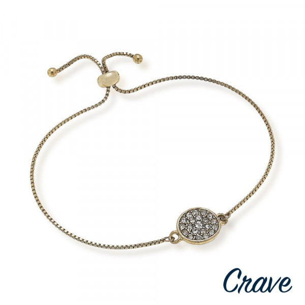 """Dainty bolo bracelet featuring a circular focal with cubic zirconia details and a adjustable closure. Approximately 3"""" in diameter. Fits up to a 6"""" wrist."""