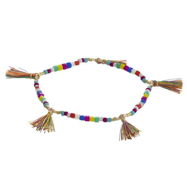 "Beaded stretch bracelet featuring square faceted bead details with tassel accents. Approximately 3"" in diameter unstretched. Fits up to a 6"" wrist."
