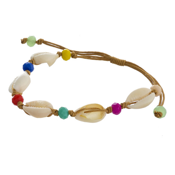 "Bolo style bracelet featuring multicolor faceted bead details and puka shell accents. Approximately 3"" in diameter. Fits up to a 6"" wrist."