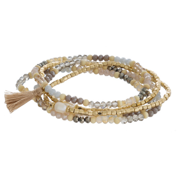 """Beaded stretch bracelet set featuring natural faceted and wood bead details with gold, tassel and pearl accents. Approximately 3"""" in diameter unstretched. Fits up to a 6"""" in wrist."""