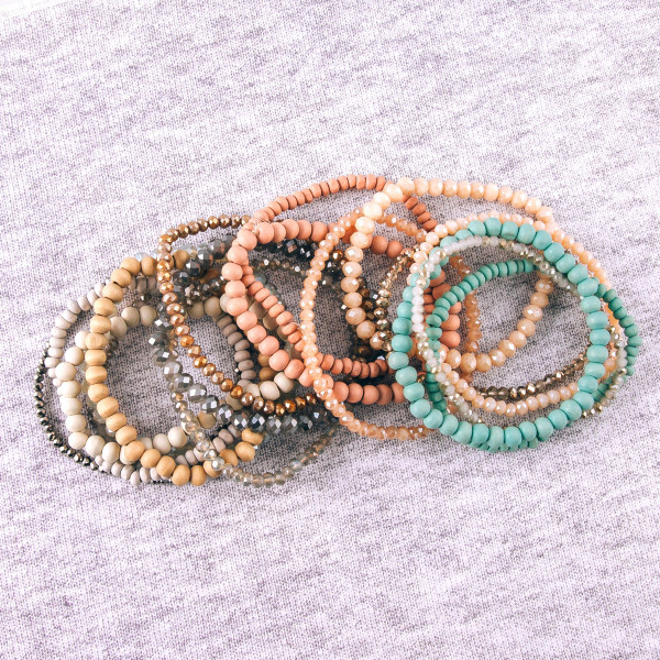 "Bracelet set featuring six beaded stretch bracelets with faceted and wood bead details. Approximately 3"" in diameter unstretched. Fits up to a 6"" wrist."