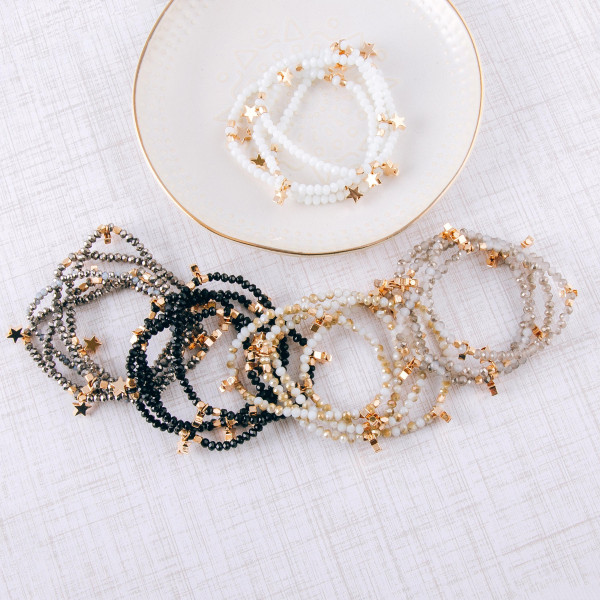 """Bracelet set featuring four faceted bead stretch bracelets with gold star accents. Approximately 3"""" in diameter unstretched. Fits up to a 6"""" wrist."""
