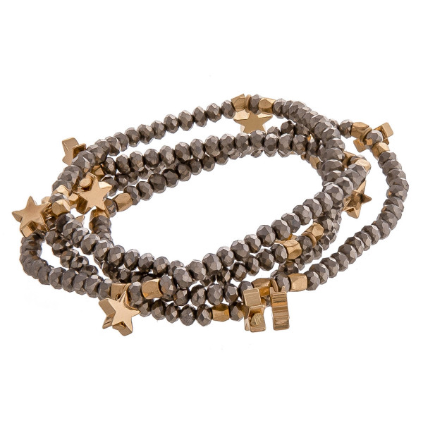"Bracelet set featuring four faceted bead stretch bracelets with gold star accents. Approximately 3"" in diameter unstretched. Fits up to a 6"" wrist."