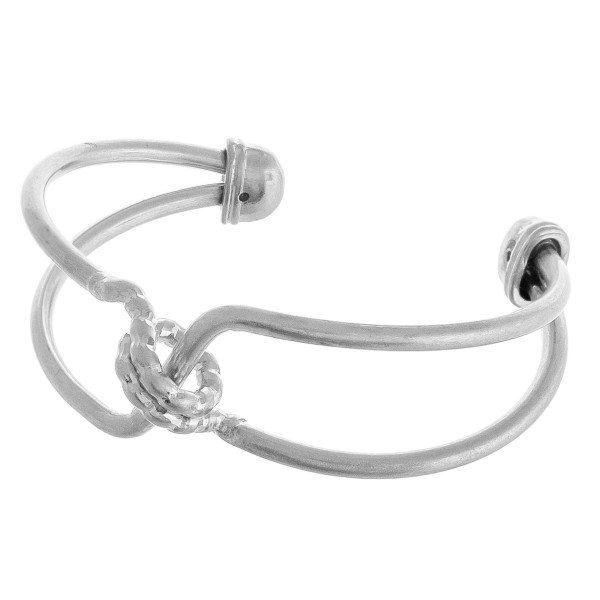 """Metal cuff bracelet featuring a twisted detail. Approximately 3"""" in diameter. Fits up to a 6"""" wrist."""