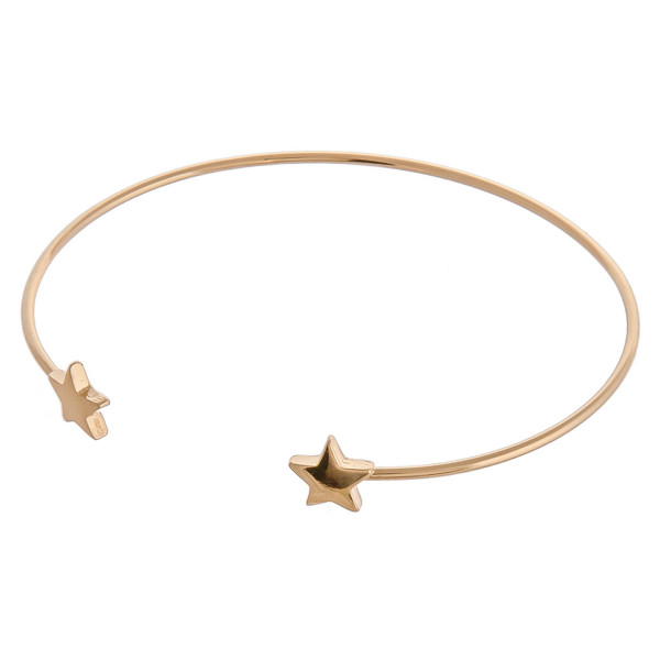 "Dainty metal cuff bracelet featuring star details. Approximately 3"" in diameter. Fits up to a 6"" wrist."